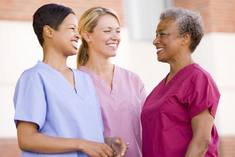 Three nurses in medical scrubs