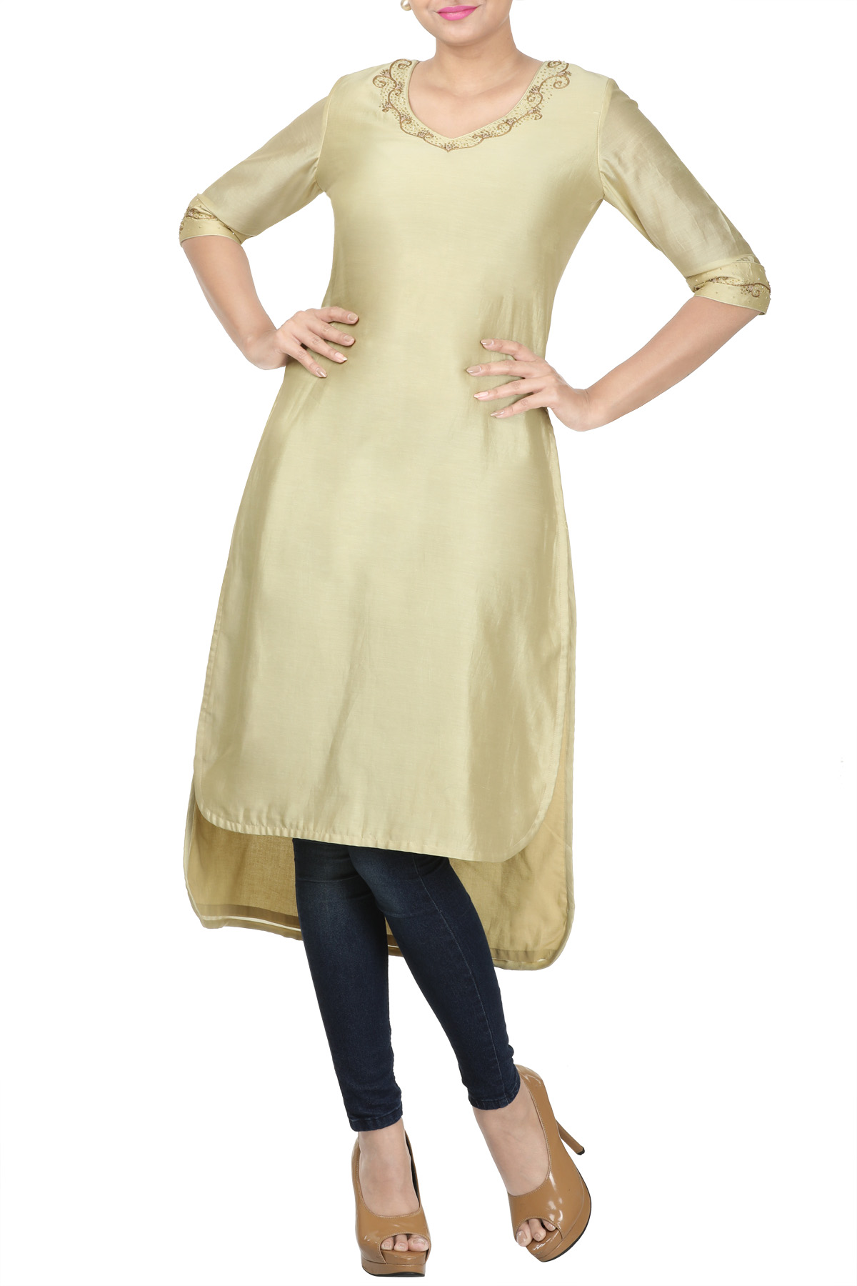 Beige Kurti with hand embroidery at neckline and sleeves.